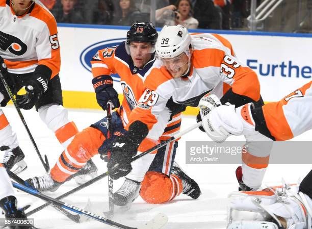Michael Cammalleri of the Edmonton Oilers battles for the puck against Mark Alt of the Philadelphia Flyers on December 6 2017 at Rogers Place in...