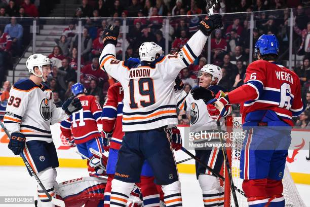 Michael Cammalleri of the Edmonton Oilers celebrates his first period goal with teammates Patrick Maroon and Ryan NugentHopkins of the Edmonton...