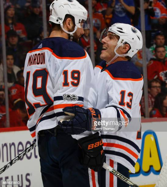 Michael Cammalleri of the Edmonton Oilers celebrates with teammate Patrick Maroon after a goal against the Calgary Flames at Scotiabank Saddledome on...