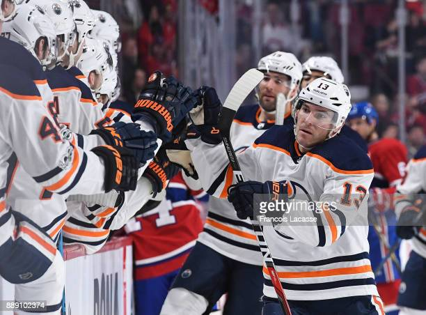 Michael Cammalleri of the Edmonton Oilers celebrates with the bench after scoring a goal against the Montreal Canadiens in the NHL game at the Bell...