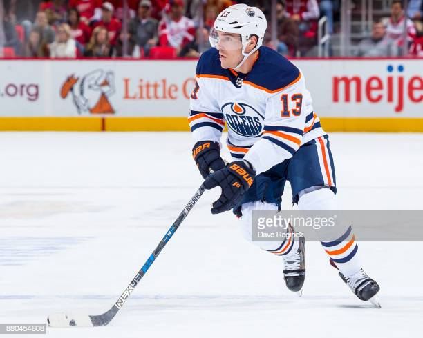 Michael Cammalleri of the Edmonton Oilers skates up ice with the puck against the Detroit Red Wings during an NHL game at Little Caesars Arena on...