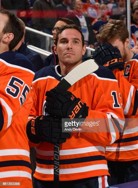 Michael Cammalleri of the Edmonton Oilers stands for the singing of the national anthem prior to the game against the Arizona Coyotes on November 28...