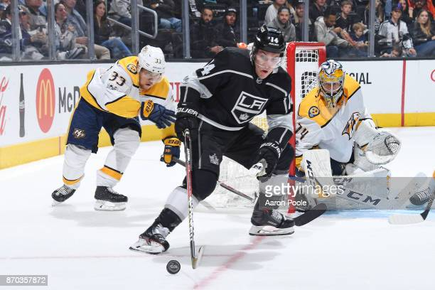 Michael Cammalleri of the Los Angeles Kings controls the puck against Viktor Arvidsson and Juuse Saros of the Nashville Predators at STAPLES Center...