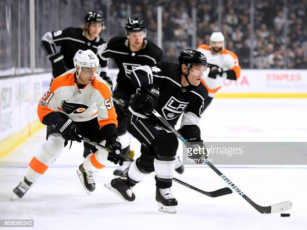 Michael Cammalleri of the Los Angeles Kings makes a pass from Valtteri Filppula of the Philadelphia Flyers during opening night of the Los Angeles...