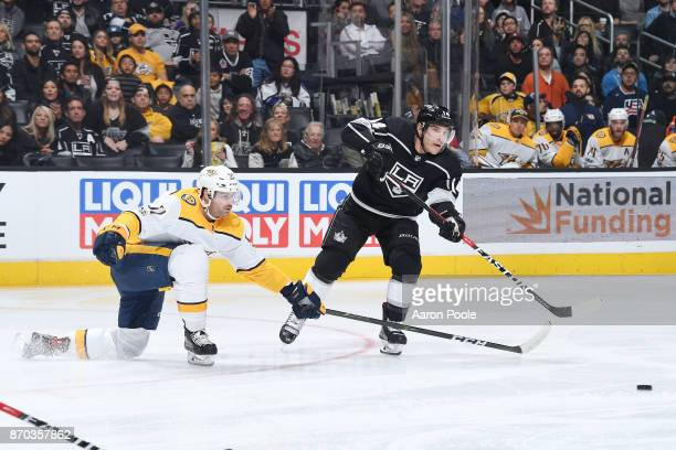 Michael Cammalleri of the Los Angeles Kings passes the puck against Austin Watson of the Nashville Predators at STAPLES Center on November 4 2017 in...