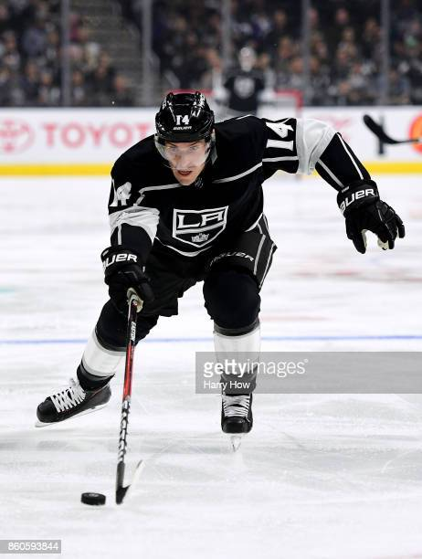 Michael Cammalleri of the Los Angeles Kings reaches for the puck during the game against the Calgary FlameCalgary Flamesat Staples Center on October...