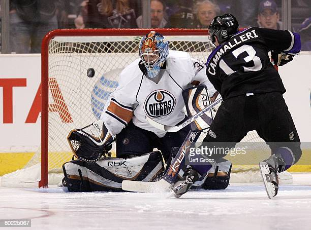 Michael Cammalleri of the Los Angeles Kings skates in for the scoring attempt against goaltender Mathieu Garon of the Edmonton Oilers during their...