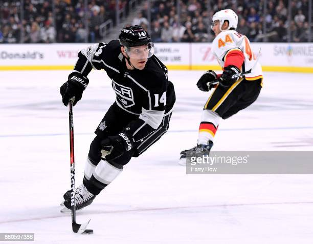 Michael Cammalleri of the Los Angeles Kings turns with the puck from Matt Bartkowski of the Calgary Flames at Staples Center on October 11 2017 in...