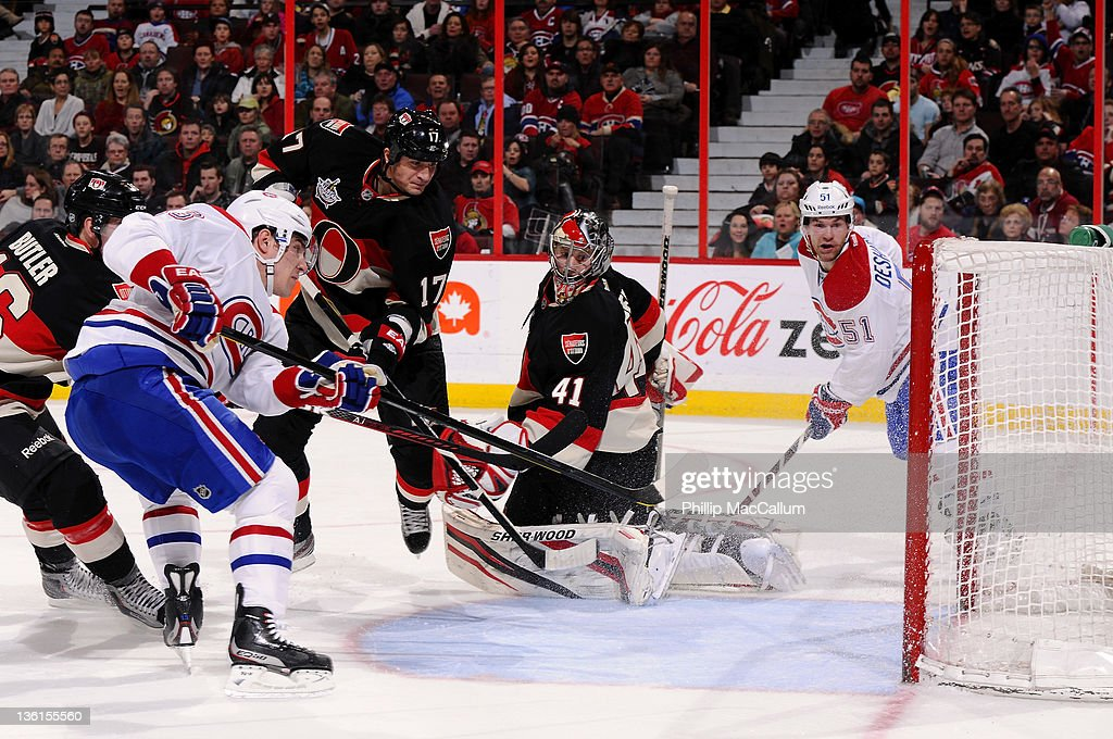 Michael Cammalleri #13 of the Montreal Canadiens fires a rebound into the net for a goal in behind <a gi-track='captionPersonalityLinkClicked' href=/galleries/search?phrase=Craig+Anderson&family=editorial&specificpeople=211238 ng-click='$event.stopPropagation()'>Craig Anderson</a> #41 of the Ottawa Senators during a game at Scotiabank Place on December 27, 2011 in Ottawa, Ontario, Canada.