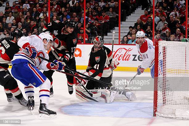 Michael Cammalleri of the Montreal Canadiens fires a rebound into the net for a goal in behind Craig Anderson of the Ottawa Senators during a game at...