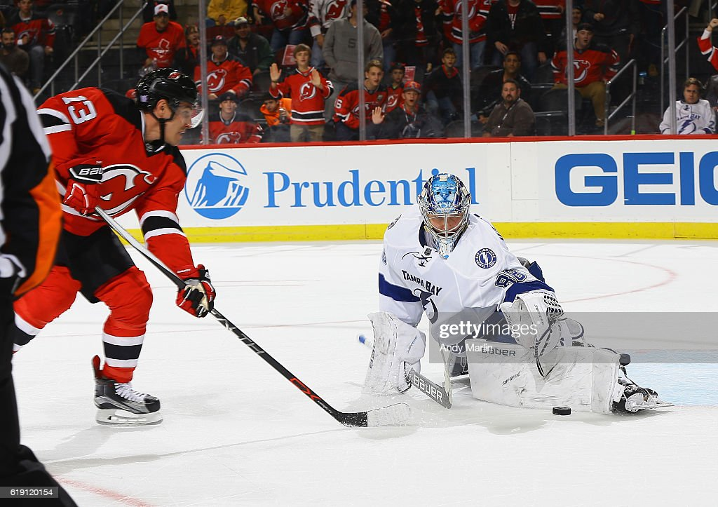 Michael Cammalleri #13 of the New Jersey Devils is stopped on a breakaway by Andrei Vasilevsky #88 of the Tampa Bay Lightning on a breakaway during the game at Prudential Center on October 29, 2016 in Newark, New Jersey. The Devils defeated the Lightning 3-1.