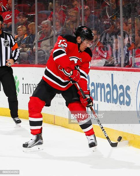 Michael Cammalleri of the New Jersey Devils plays the puck against the New York Islanders during the game at Prudential Center on April 8 2017 in...