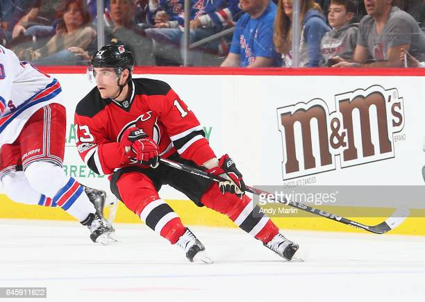 Michael Cammalleri of the New Jersey Devils skates against the New York Rangers during the game at Prudential Center on February 25 2017 in Newark...