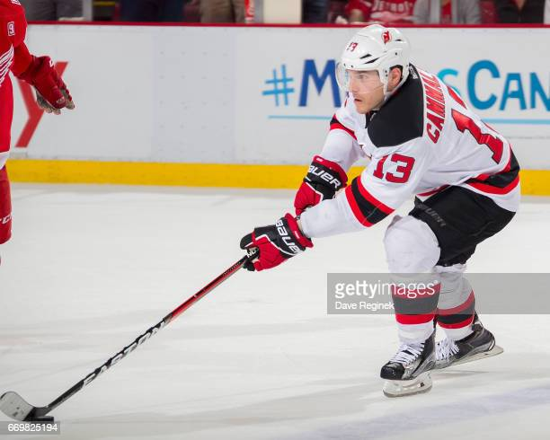 Michael Cammalleri of the New Jersey Devils skates with the puck against the Detroit Red Wings during the final home game ever played at Joe Louis...