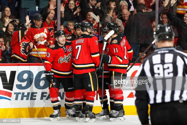 Michael Cammalleri TJ Brodie Mikael Backlund and Mark Giordano of the Calgary Flames celebrate a goal against the New York Rangers at Scotiabank...