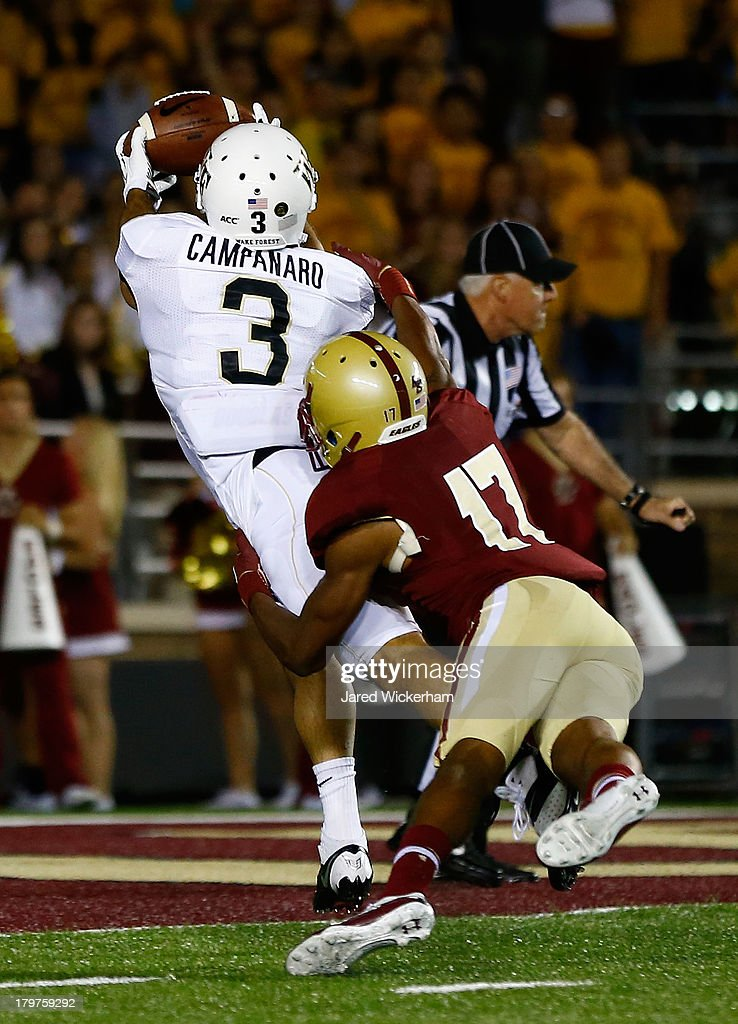 Michael Campanaro #3 of the Wake Forest Demon Deacons catches a touchdown pass in front of Bryce Jones #17 of the Boston College Eagles in the first quarter during the game on September 6, 2013 at Alumni Stadium in Chestnut Hill, Massachusetts.