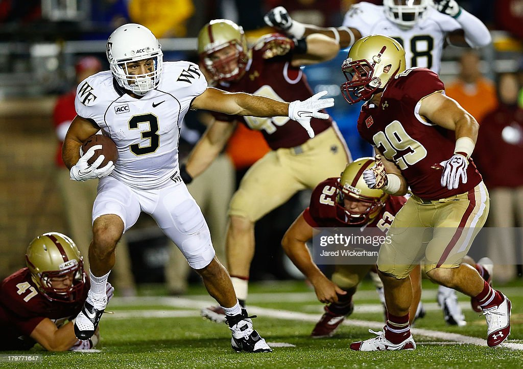 Michael Campanaro #3 of the Wake Forest Demon Deacons runs with the ball on a punt return against James McCaffrey #29 of the Boston College Eagles during the game on September 6, 2013 at Alumni Stadium in Chestnut Hill, Massachusetts.