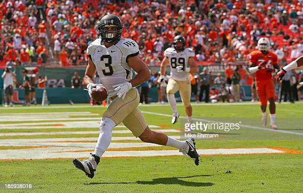 Michael Campanaro of the Wake Forest Demon Deacons scores a touchdown during a game against the Miami Hurricanes at Sun Life Stadium on October 26...