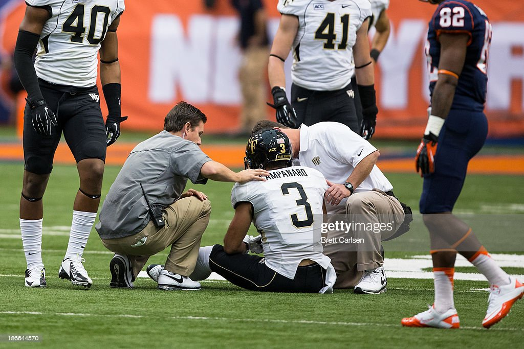 Michael Campanaro #3 of Wake Forest Demon Deacons is attended to by trainers in the first quarter following a third down reception on November 2, 2013 against Syracuse Orange at the Carrier Dome in Syracuse, New York. Syracuse shuts out Wake Forest 13-0