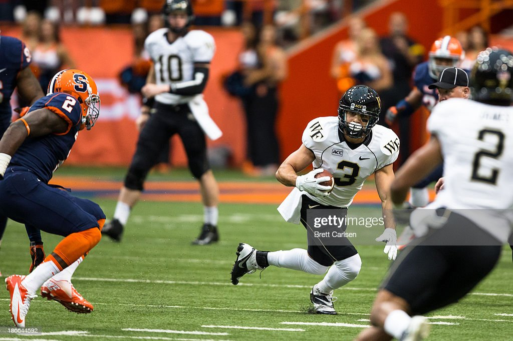 Michael Campanaro #3 of Wake Forest Demon Deacons runs after a reception in the first quarter against Syracuse Orange; he is shaken up on the play, on November 2, 2013 at the Carrier Dome in Syracuse, New York. Syracuse shuts out Wake Forest 13-0