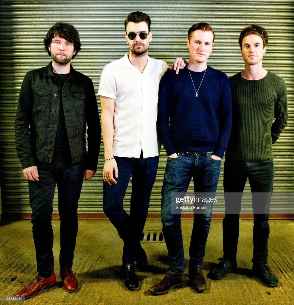 Michael Campbell Liam Fray Daniel 'Conan' Moores and Mark Cuppello of The Courteeners pose backstage after signing copies of their new album...