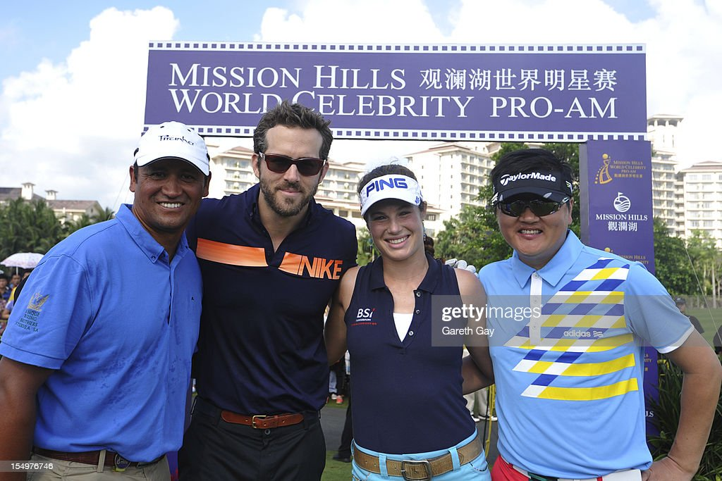 Michael Campbell, Ryan Reynolds, Liebelei Lawrence and Sun Nan arrive for the firts tee on Day 4 of the Mission Hills World Celebrity Pro-Am at Mission Hills Haikou resort on October 21, 2012 in Haikou, China.