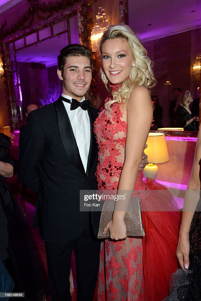 Michael Campion (L) and Miss Prestige National 2012 Christelle Roca attend the The Bests Awards 2012 Ceremony at the Salons Hoche on December 11, 2012 in Paris, France.