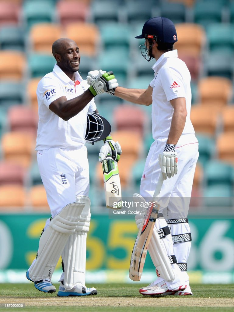 <a gi-track='captionPersonalityLinkClicked' href=/galleries/search?phrase=Michael+Carberry&family=editorial&specificpeople=600686 ng-click='$event.stopPropagation()'>Michael Carberry</a> of England celebrates his century with captain <a gi-track='captionPersonalityLinkClicked' href=/galleries/search?phrase=Alastair+Cook+-+Cricket+Player&family=editorial&specificpeople=571475 ng-click='$event.stopPropagation()'>Alastair Cook</a> during day one of the tour match between Australia A and England at Blundstone Arena on November 6, 2013 in Hobart, Australia.