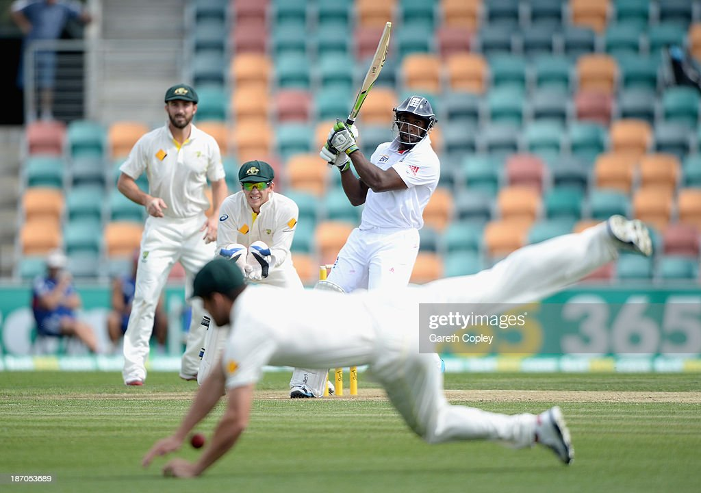 <a gi-track='captionPersonalityLinkClicked' href=/galleries/search?phrase=Michael+Carberry&family=editorial&specificpeople=600686 ng-click='$event.stopPropagation()'>Michael Carberry</a> of England hits the ball past Moises Henriques of Australia A during day one of the tour match between Australia A and England at Blundstone Arena on November 6, 2013 in Hobart, Australia.