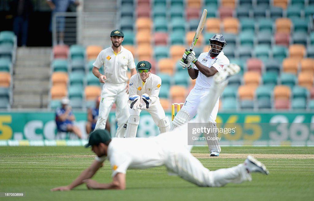 Michael Carberry of England hits the ball past Moises Henriques of Australia A during day one of the tour match between Australia A and England at Blundstone Arena on November 6, 2013 in Hobart, Australia.
