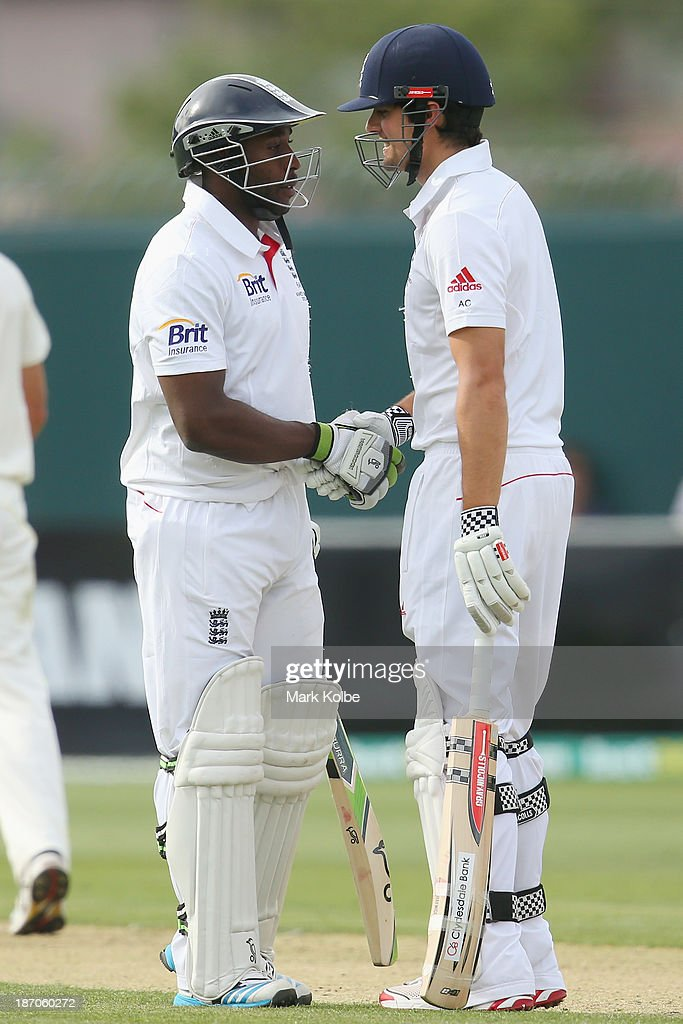 <a gi-track='captionPersonalityLinkClicked' href=/galleries/search?phrase=Michael+Carberry&family=editorial&specificpeople=600686 ng-click='$event.stopPropagation()'>Michael Carberry</a> of England is congratulated by <a gi-track='captionPersonalityLinkClicked' href=/galleries/search?phrase=Alastair+Cook+-+Cricket+Player&family=editorial&specificpeople=571475 ng-click='$event.stopPropagation()'>Alastair Cook</a> of England as he celebrates scoring his 150 during day one of the tour match between Australia A and England at Blundstone Arena on November 6, 2013 in Hobart, Australia.