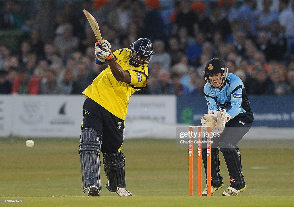 Michael Carberry of Hampshire drives home during the Friends Life T20 match between Sussex Sharks and Hampshire Royals at The Brighton and Hove Jobs County Ground on July 05, 2013 in Hove, England.