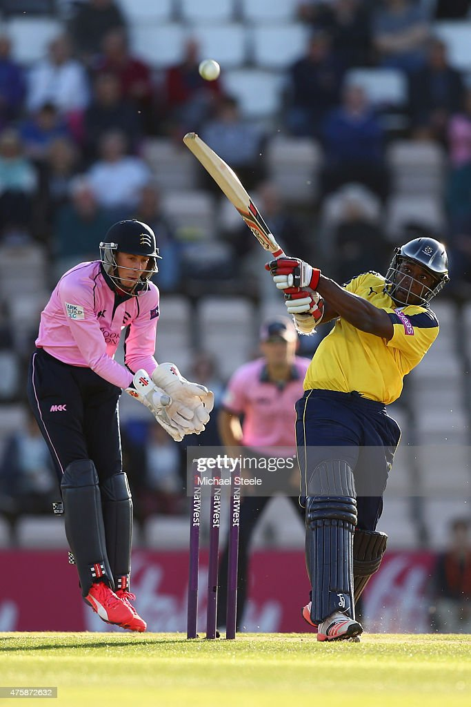 Michael Carberry of Hampshire hits out as wicketkeeper Joe Simpson of Middlesex looks on during the NatWest T20 Blast match between Hampshire and...