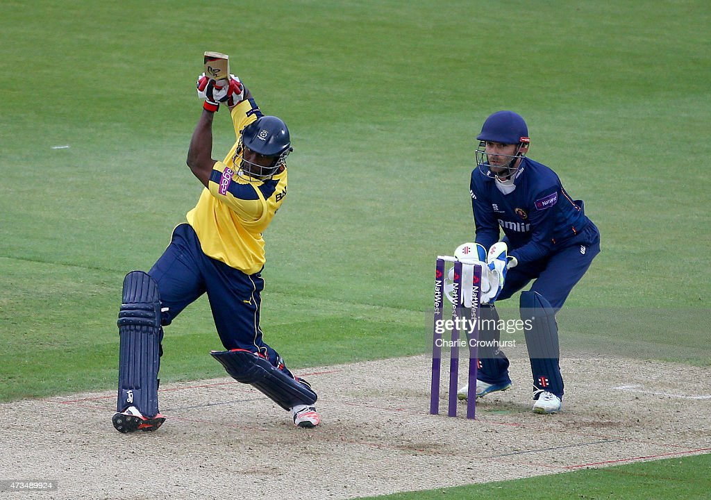 Michael Carberry of Hampshire hits out while James Foster of Essex looks on during the Natwest T20 Blast match between Hampshire and Essex at The...