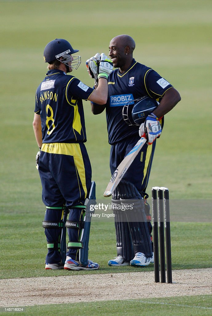 Michael Carberry of Hampshire (R) is congratulated by team-mate Liam Dawson after reaching his century during the Clydesdale Bank Pro40 match between the Hampshire Royals and the Scottish Saltires on June 4, 2012 in Southampton, England.