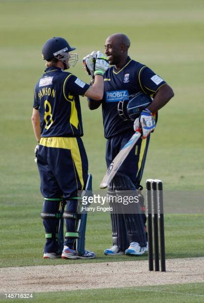 Michael Carberry of Hampshire is congratulated by teammate Liam Dawson after reaching his century during the Clydesdale Bank Pro40 match between the...