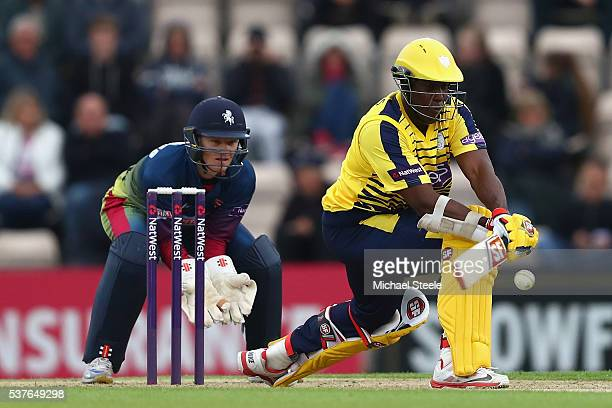 Michael Carberry of Hampshire reverse sweeps as wicketkeeper Sam Billings of Kent looks on during the NatWest T20 Blast match between Hampshire and...