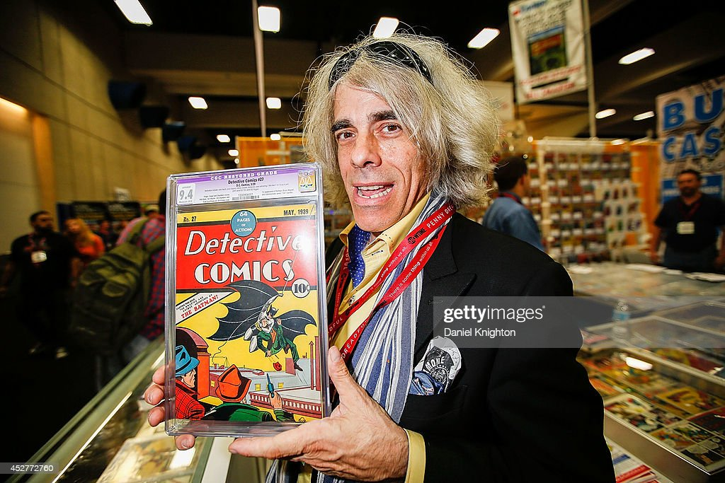 Michael Carbonaro of D&A Cardworld poses with Detective Comics #27 at Comic-Con International at San Diego Convention Center on July 26, 2014 in San Diego, California. The May 1939 issue marks the first appearance of the Batman character and is valued at approximately $550,000.