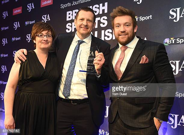 Michael Carr receives The Radio Sport Live Broadcast Award from Pam Melbourne and Dan Greaves during the The SJA British Sports Journalism Awards on...
