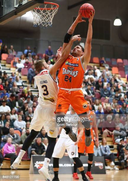 Michael Carrera of the Cairns Taipans drives to the basket during the 2017 NBL Blitz preseason match between the Cairns Taipans and Brisbane Bullets...
