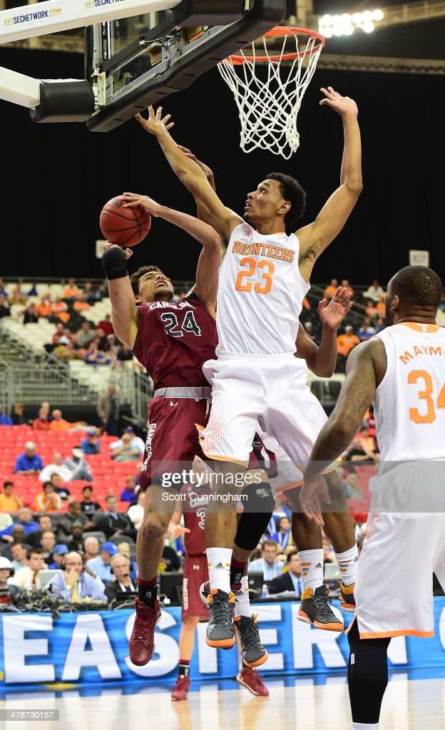 Michael Carrera #24 of the South Carolina Gamecocks puts up a shot against Derek Reese #23 of the Tennessee Volunteers during the quarterfinals of the SEC Men's Basketball Tournament at the Georgia Dome on March 14, 2014 in Atlanta, Georgia. Photo by Scott Cunningham/Getty Images)