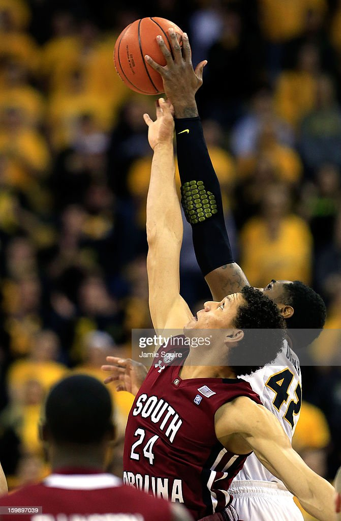 Michael Carrera #24 of the South Carolina Gamecocks tips off against Alex Oriakhi #42 of the Missouri Tigers during the game at Mizzou Arena on January 22, 2013 in Columbia, Missouri.