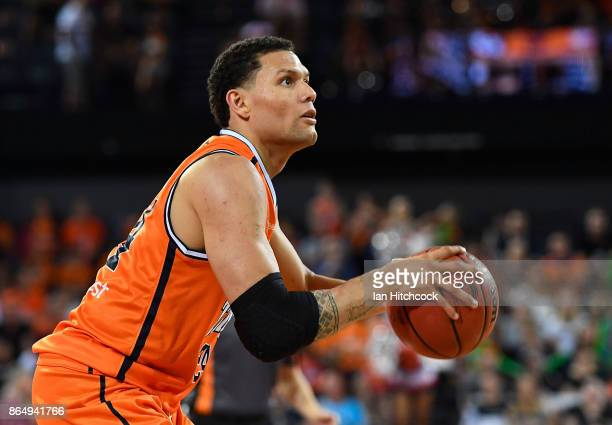 Michael Carrera of the Taipans looks to make a shot during the round three NBL match between the Cairns Taipans and the Perth Wildcats at Cairns...