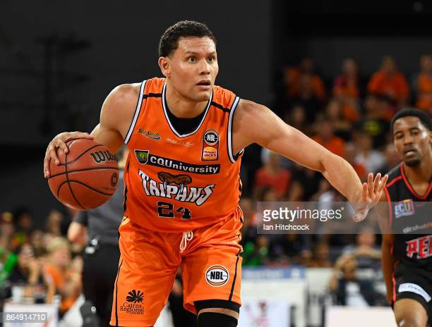 Michael Carrera of the Taipans looks to pass the ball during the round three NBL match between the Cairns Taipans and the Perth Wildcats at Cairns...
