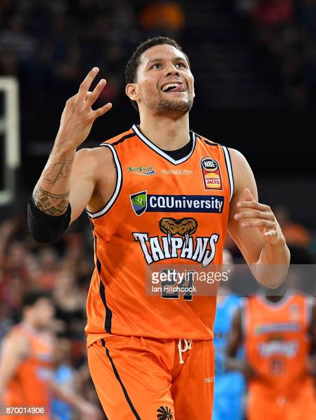 Michael Carrera of the Taipans reacts after scoring a three point shot during the round five NBL match between the Cairns Taipans and the New Zealand...