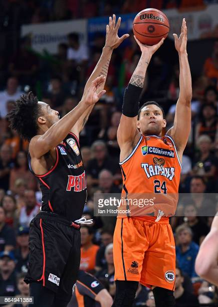 Michael Carrera of the Taipans take a shot during the round three NBL match between the Cairns Taipans and the Perth Wildcats at Cairns Convention...