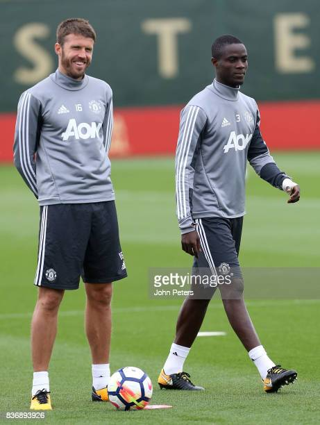 Michael Carrick and Eric Bailly of Manchester United in action during a first team training session at Aon Training Complex on August 22 2017 in...