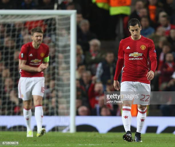 Michael Carrick and Henrikh Mkhitaryan of Manchester United react to conceding a goal to Sofiane Hanni of RSC Anderlecht during the UEFA Europa...