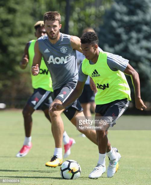 Michael Carrick and Jesse Lingard of Manchester United in action during a first team training session as part of their preseason tour of the USA on...