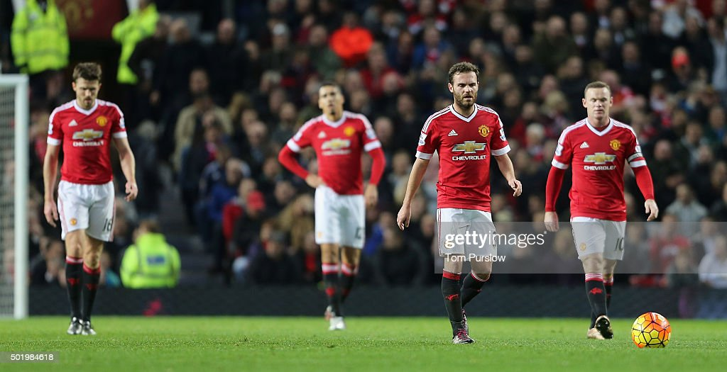 Michael Carrick Chris Smalling Juan Mata and Wayne Rooney of Manchester United react to Cameron Jerome of Norwich City scoring their first goal...